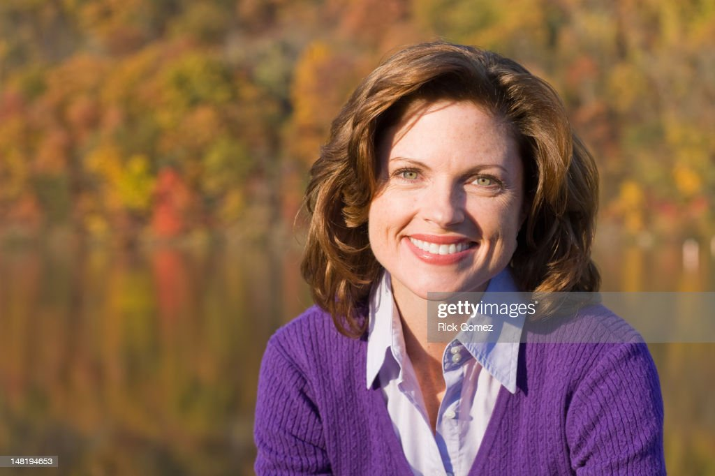 Smiling Caucasian woman outdoors in autumn : Stock Photo