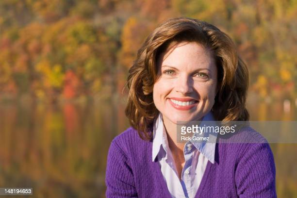 Smiling Caucasian woman outdoors in autumn
