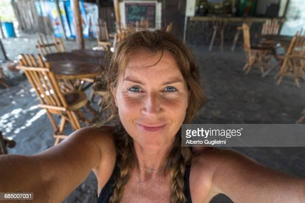 Smiling Caucasian woman posing for self-portrait