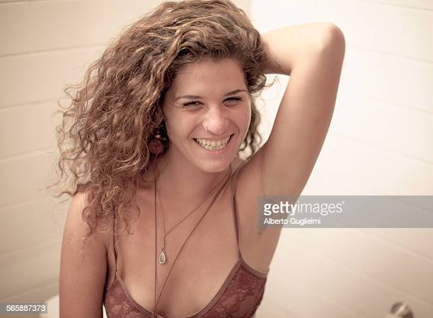 Smiling Caucasian woman showing armpit hair
