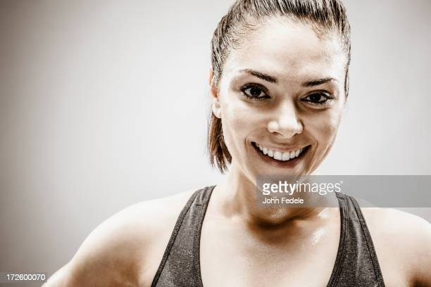 Smiling Caucasian woman sweating during workout
