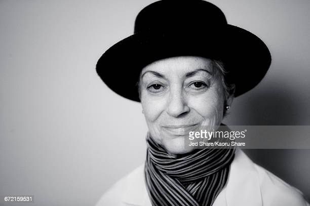 Smiling Caucasian woman wearing scarf and hat