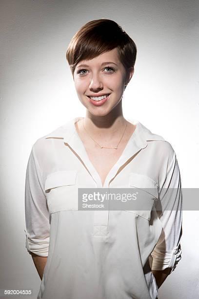 Smiling Caucasian woman wearing white shirt
