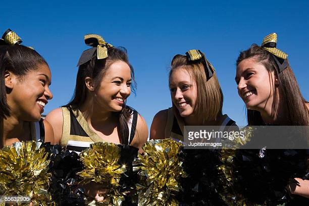smiling cheerleaders - black cheerleaders stock photos and pictures