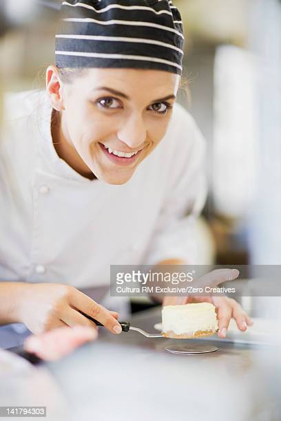 Smiling chef at work in kitchen