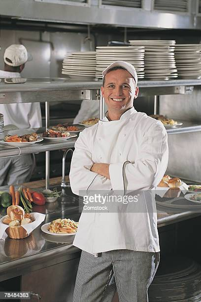 smiling chef - three quarter length stock pictures, royalty-free photos & images