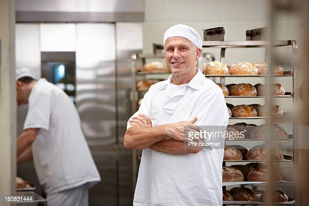 Smiling chef standing in kitchen