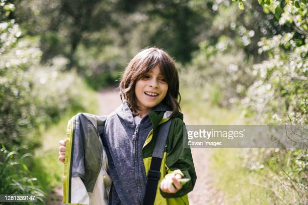 smiling child exploring in nature by path - petaluma stock pictures, royalty-free photos & images