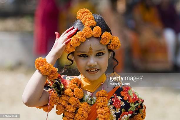 A smiling child in festive dress on the cultural program organized by students of Fine Art Institute of Dhaka University marking Basanta Utsav the...