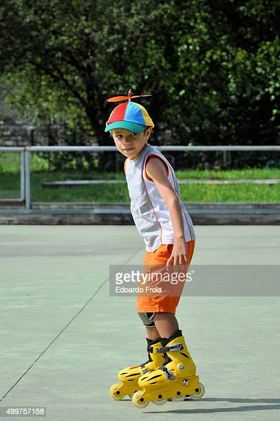 Smiling child with inline skates