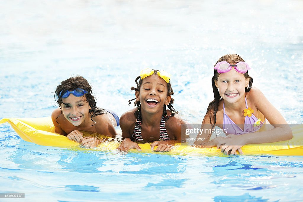 Smiling children in pool : Stock Photo