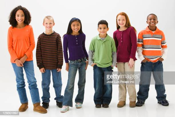 smiling children standing together - 8 9 years photos stock photos and pictures