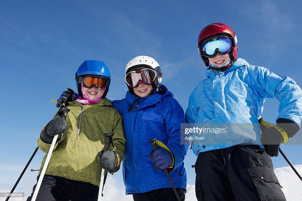420de2c18714 Smiling Children Wearing Ski Gear Stock Photo