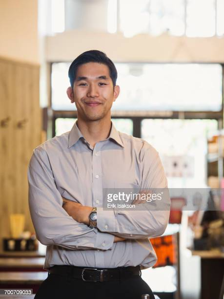 Smiling Chinese man posing in restaurant