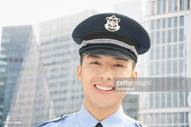 smiling chinese policeman - lieutenant stock pictures, royalty-free photos & images