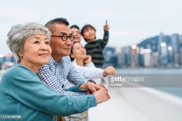 smiling chinese senior couple enjoying hong kong views - observation point stock pictures, royalty-free photos & images