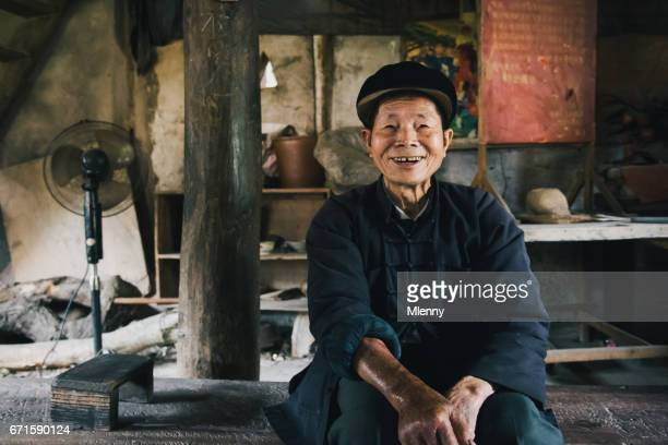 smiling chinese senior man chengyang china real people portrait - village stock pictures, royalty-free photos & images