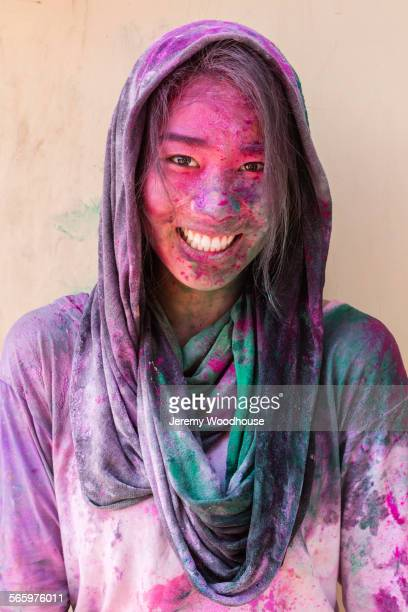 smiling chinese woman splattered in pigment powder - radha krishna stock pictures, royalty-free photos & images