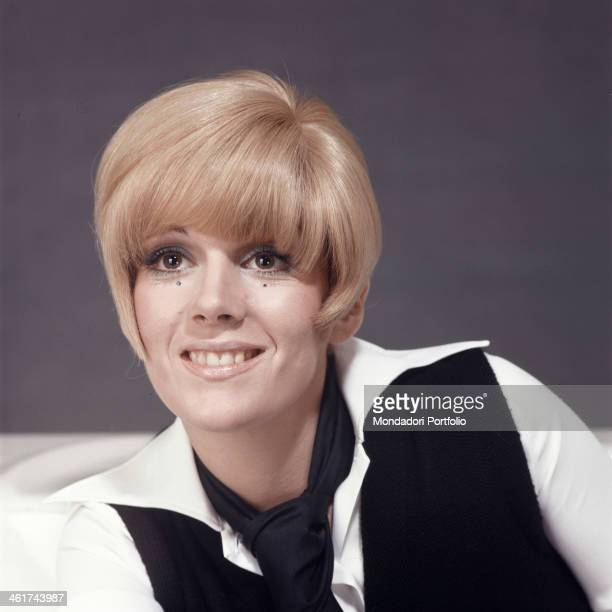 Smiling closeup of the singer Caterina Caselli native of Modena wearing a white shirt and a black tie she was named Golden Bob for the hairstyle she...