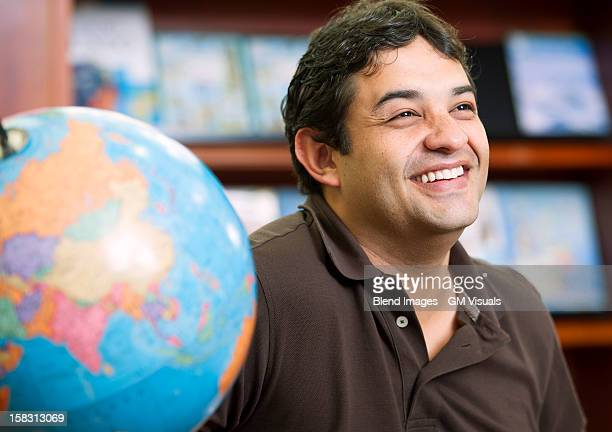 Smiling Colombian man in library