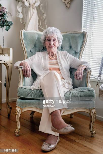 a smiling, confident 100-year old woman in her home - over 100 stock photos and pictures