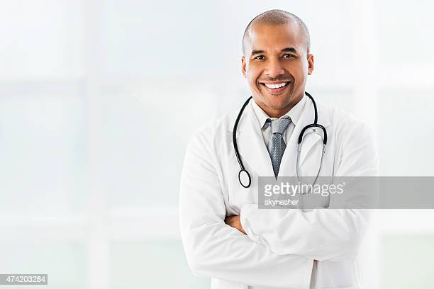 Smiling confident African American doctor looking at camera.