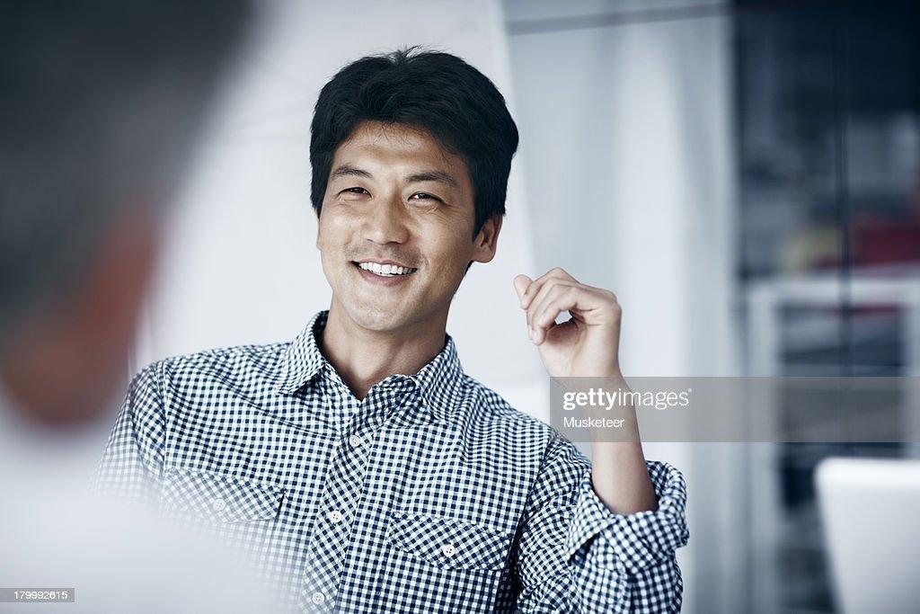 Smiling confident businessman : Stock Photo
