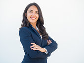 Smiling confident businesswoman posing with arms folded