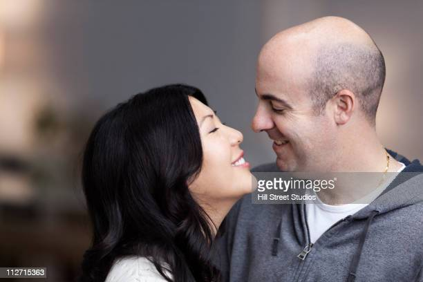 Smiling couple about to kiss