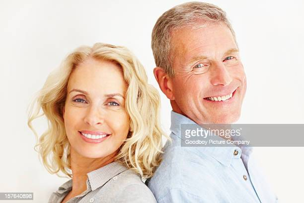 Smiling couple against white background