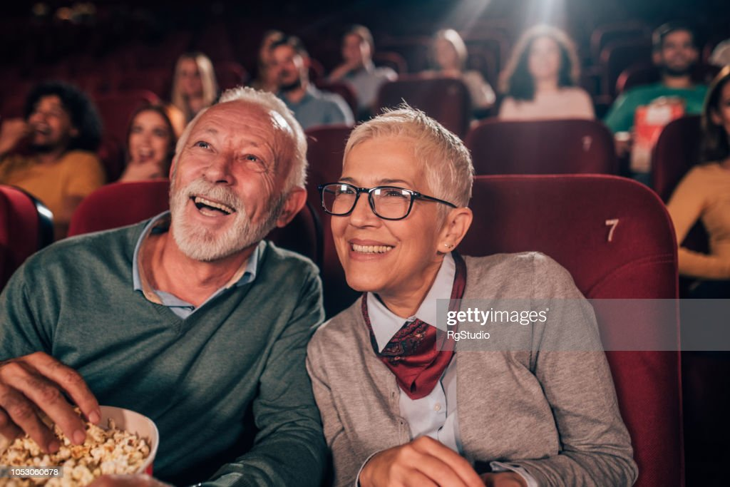 Smiling couple at cinema : Stock Photo