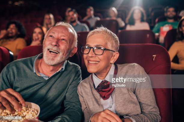 smiling couple at cinema - film industry stock pictures, royalty-free photos & images