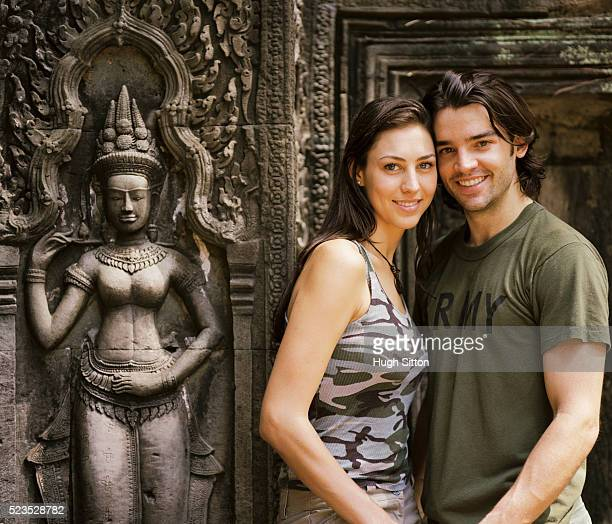 smiling couple at old temple - hugh sitton stock pictures, royalty-free photos & images