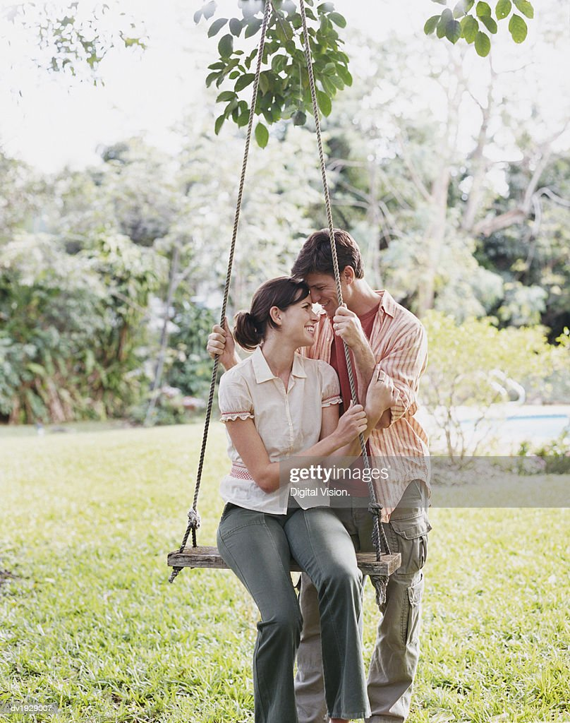 Smiling Couple By a Swing : Stock Photo