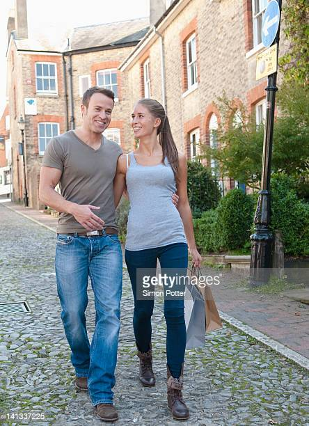Smiling couple carrying shopping bags