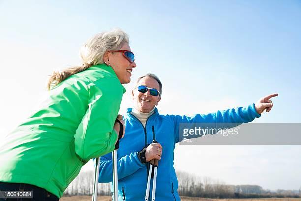 Smiling couple doing nordic walking