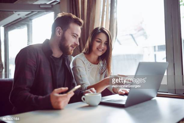 Smiling Couple Drinking Coffee and Making Video Conference in the Morning
