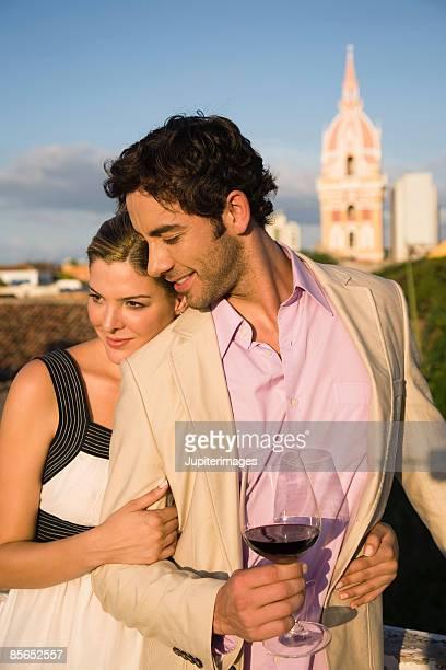smiling couple embracing, cartagena, columbia - cartagena colombia foto e immagini stock