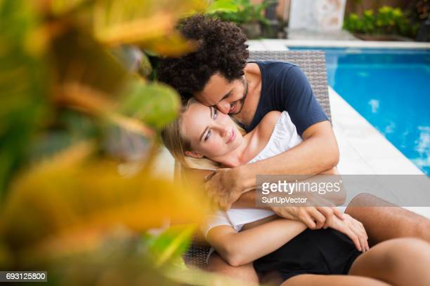 Smiling Couple Embracing Near Swimming Pool
