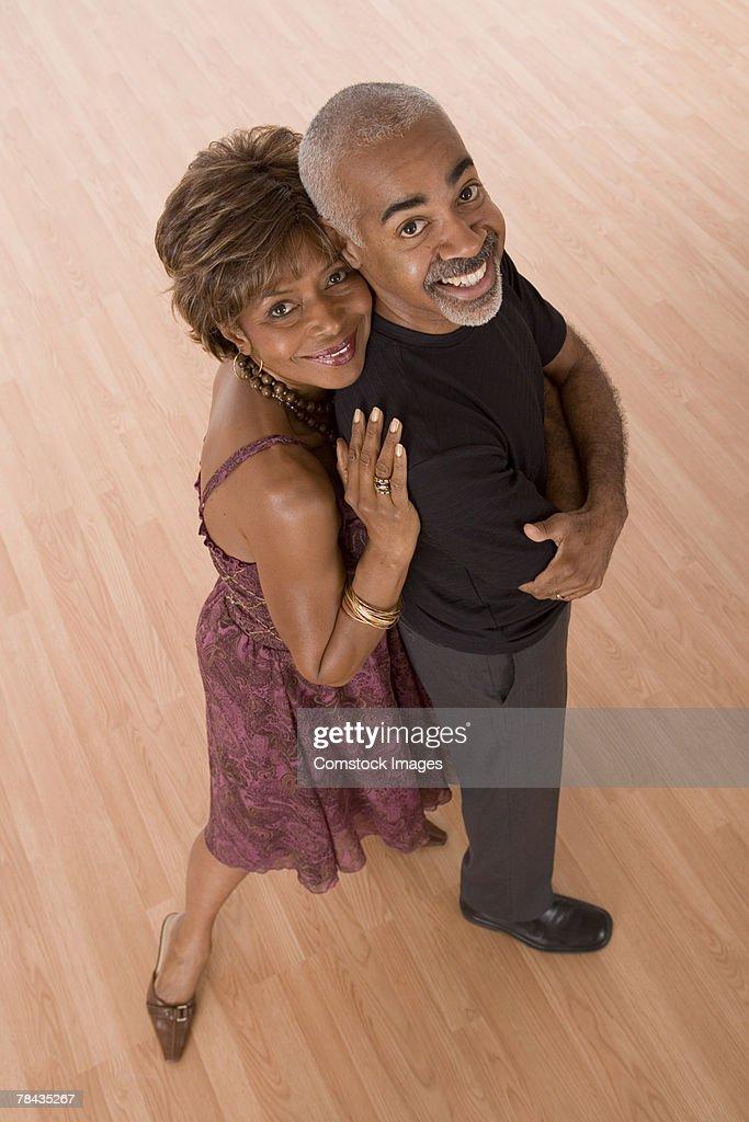 Smiling couple embracing : Stock Photo