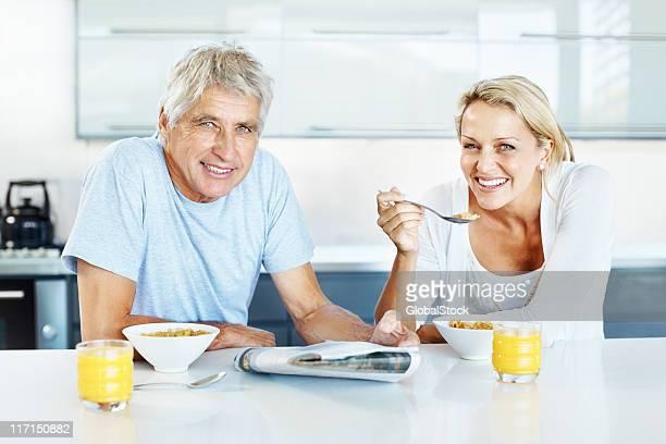 Smiling couple having breakfast