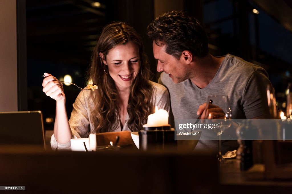 Smiling couple having dinner together : Stock Photo