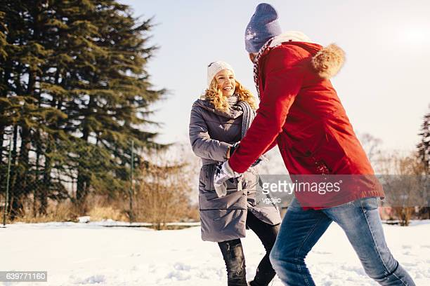 Smiling Couple Having Fun Outdoors At Winter