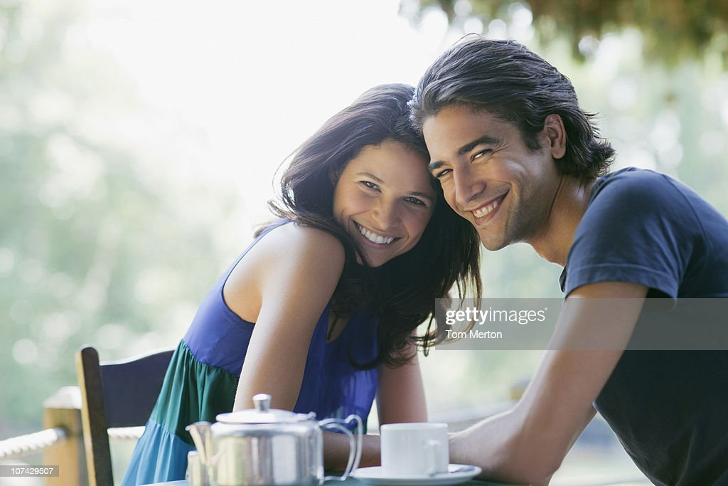Smiling couple having tea outdoors : Stock Photo