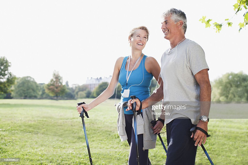 Smiling couple hiking together : Stock Photo