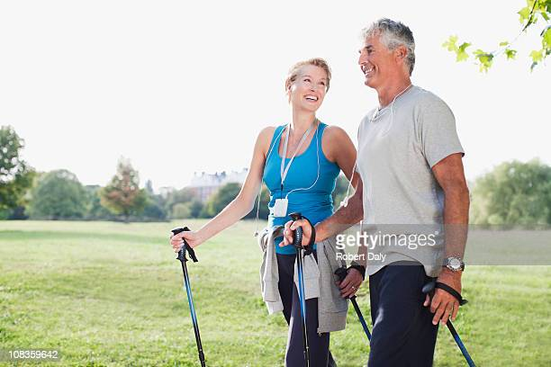 smiling couple hiking together - 50 54 years stock pictures, royalty-free photos & images