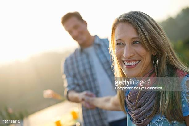 Smiling couple holding hands outdoors