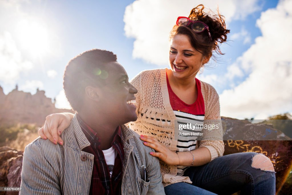 Smiling couple hugging outdoors : Foto stock