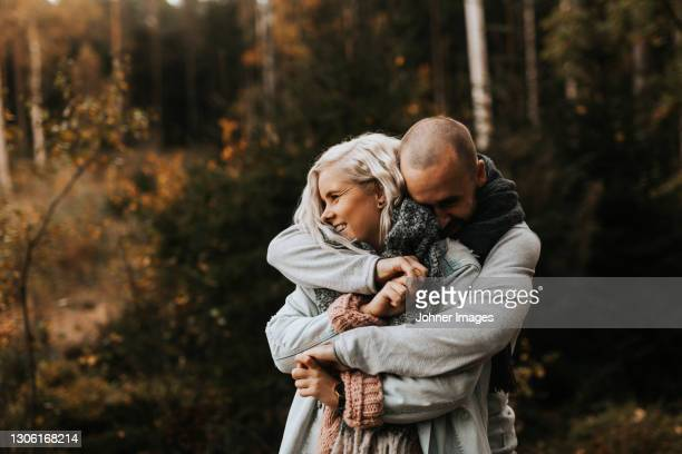 smiling couple hugging - västra götaland county stock pictures, royalty-free photos & images