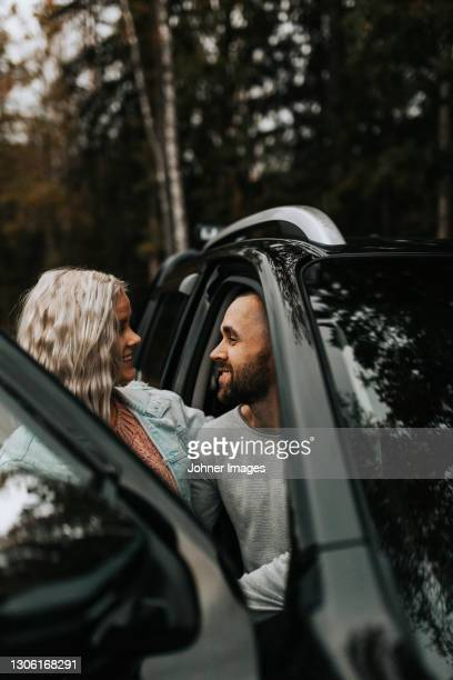 smiling couple in car - västra götaland county stock pictures, royalty-free photos & images